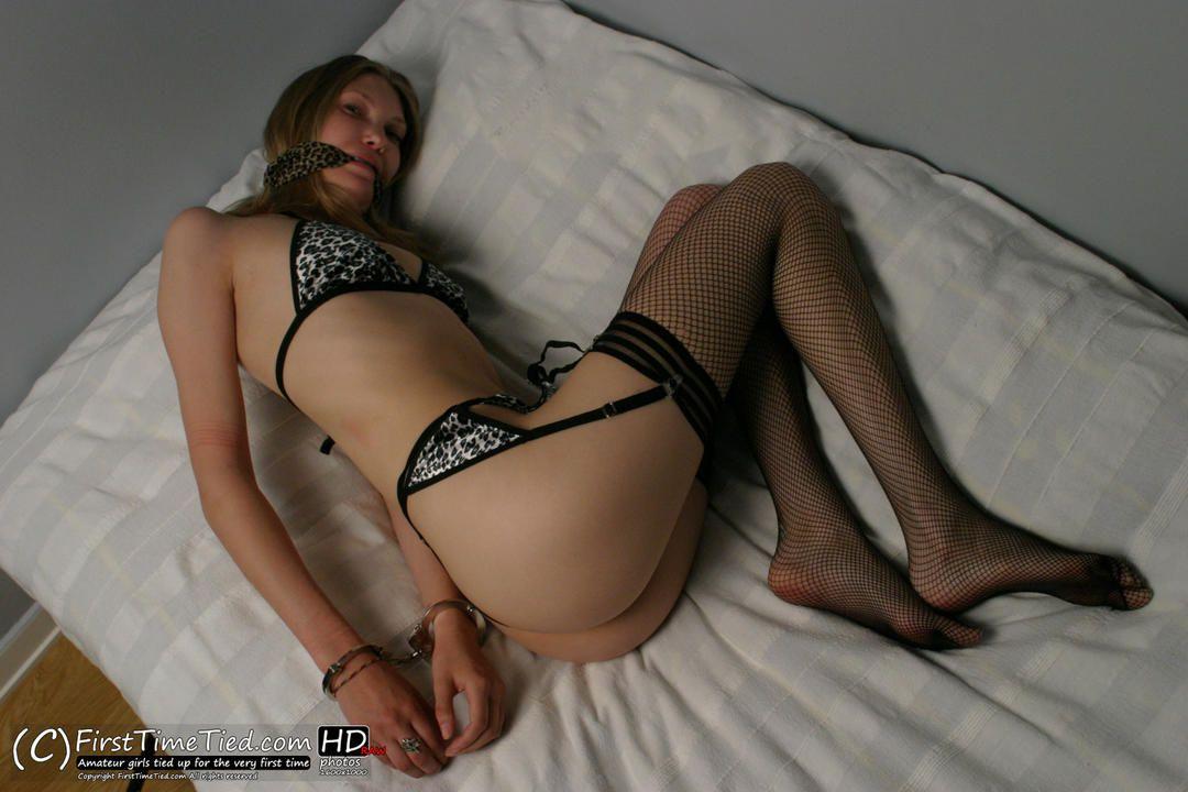 Liz handcuffed in leopard underwear and black stockings - 1