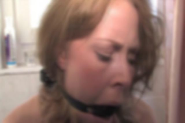 PAULA TIED UP TOPLESS AND RING GAGGED IN THE BATHROOM
