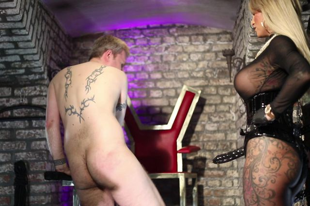 At the  Mercy of the Strap-On Mistress