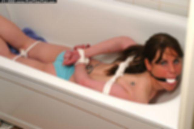 ELIN TIED UP TOPLESS AND BALLGAGGED IN THE BATHTUB