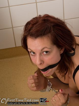 Tindra handcuffed and ballgagged in the shower - 2