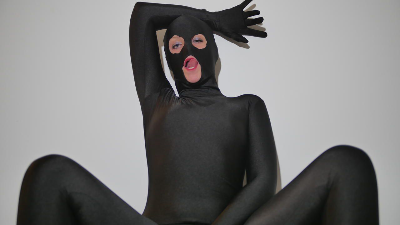 Pictures of Natacha guapa in Black zentai nylon encasement