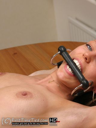 Tess table bound topless and ring gagged - 2