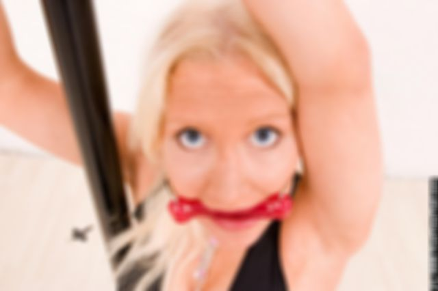 MONICA HANDCUFFED AND BIT-GAGGED IN THE STUDIO
