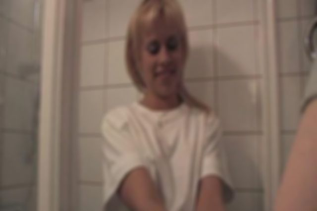 DONNA TIED UP AND ROPE-GAGGED IN THE SHOWER - BEHIND ACTION
