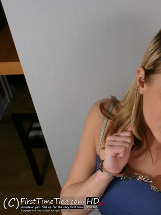 Emma handcuffed in her blue dress and high heels - 1
