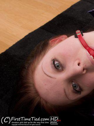 Jill hogtied barefoot and ballgagged on the floor - 2