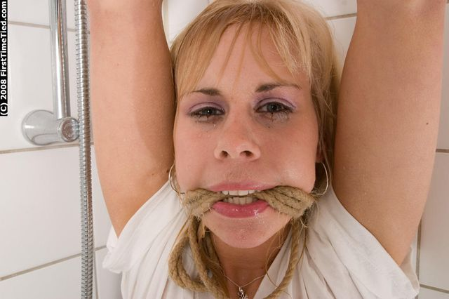 DONNA TIED UP AND ROPE-GAGGED IN THE SHOWER