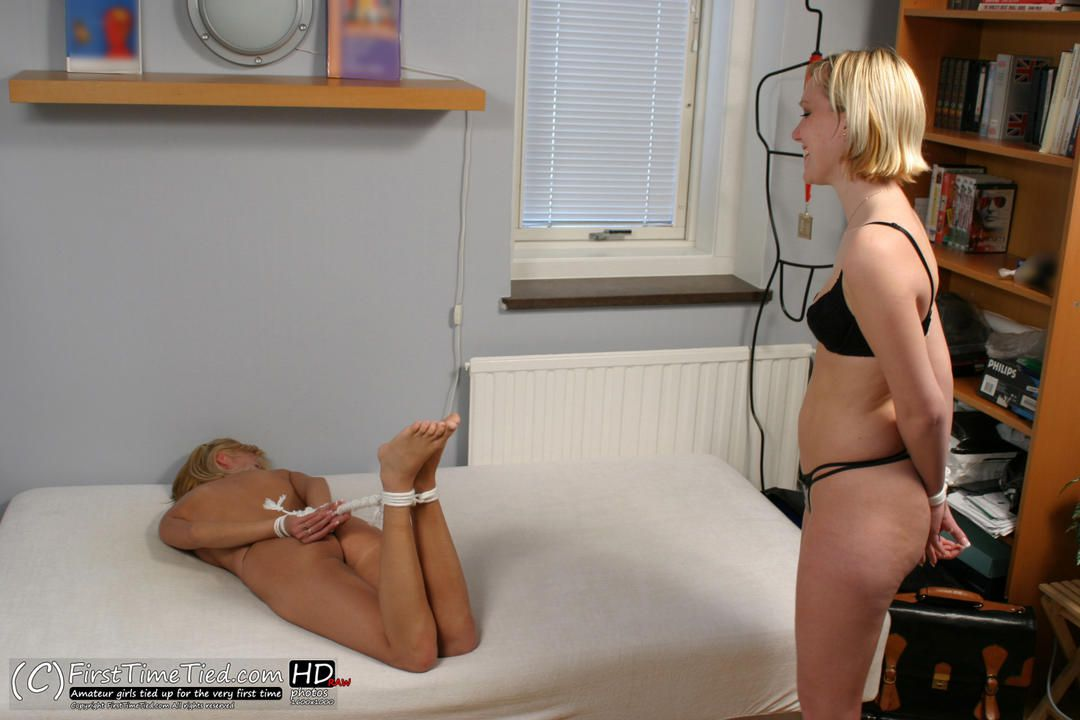 Sara and Stina hogtied together on the bed - 1
