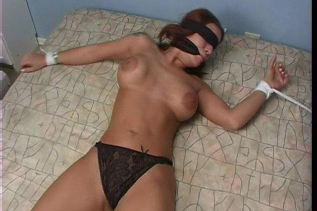 LINA RESTRAINED AND MADE HELPLESS IN BED