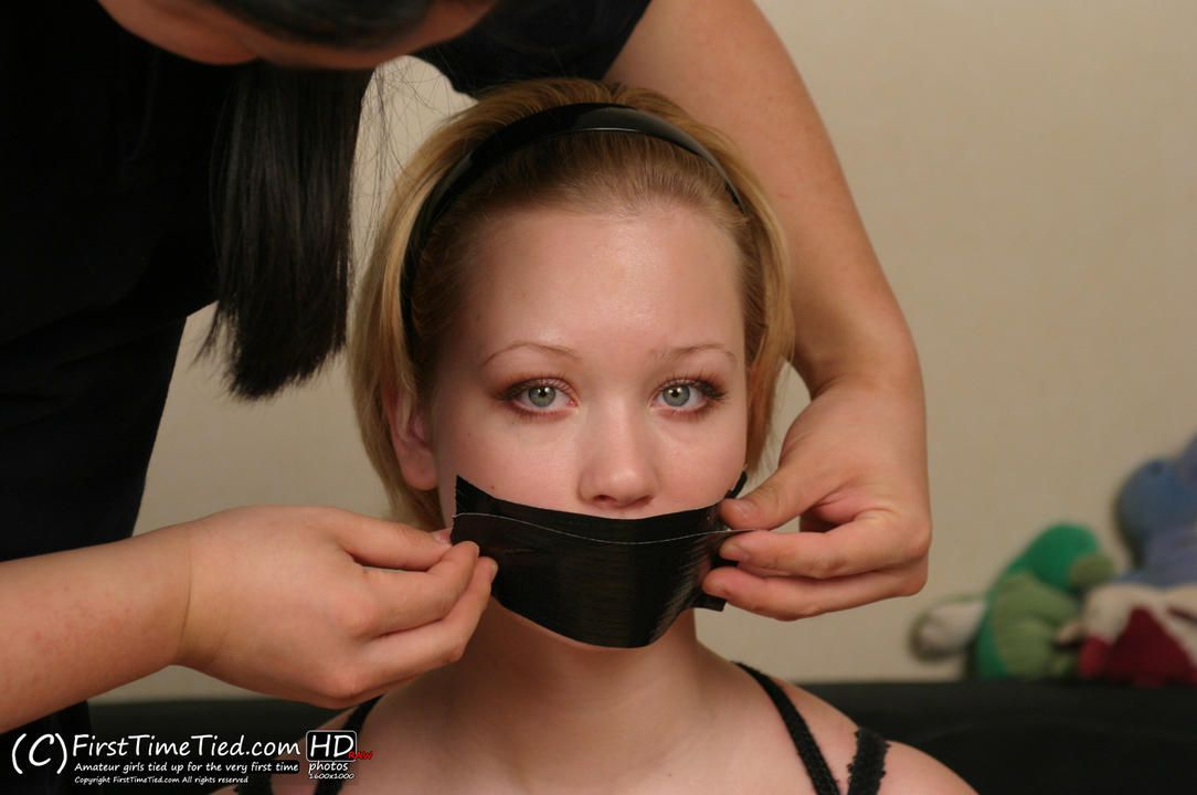 Nina harness tied and tape gagged in black underwear - 2