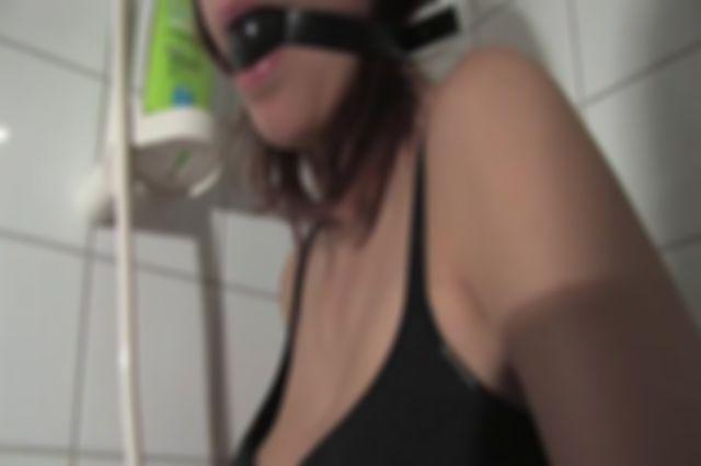 TINDRA HANDCUFFED AND BALLGAGGED IN THE BATHROOM