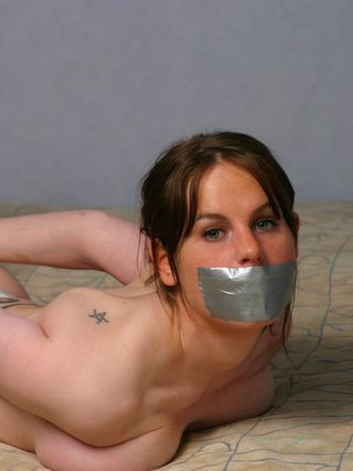 Elin handcuffed topless, tapegagged and hogtied
