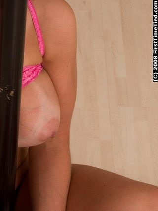 ELIN HANDCUFFED AND BALLGAGGED TOPLESS TO THE STRIPPING POLE 1