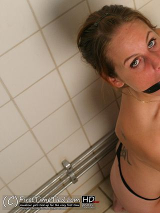 Elin handcuffed topless and ballgagged in the bathroom - 3