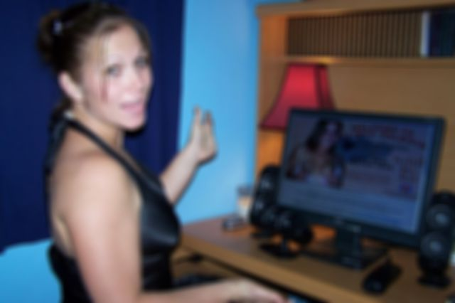Amateur Milf Toni At The Computer Showing Off Her Body