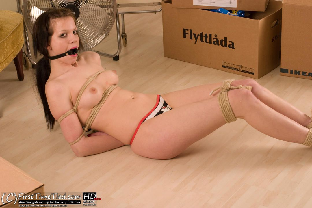 Erika tied up topless on the floor - 2