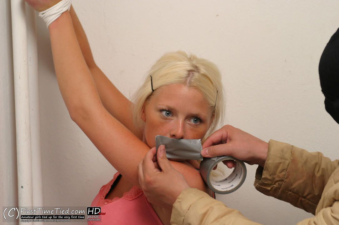 Paula tied up and tape gagged by masked burglar - 2