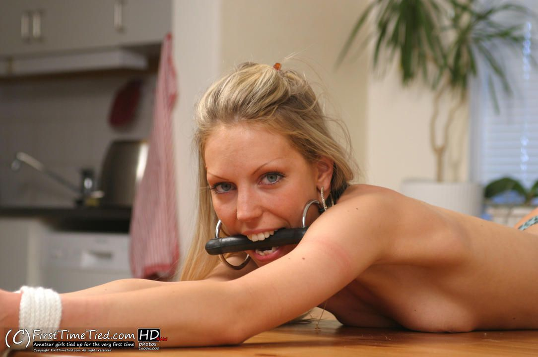 Tess table bound topless and ring gagged - 4