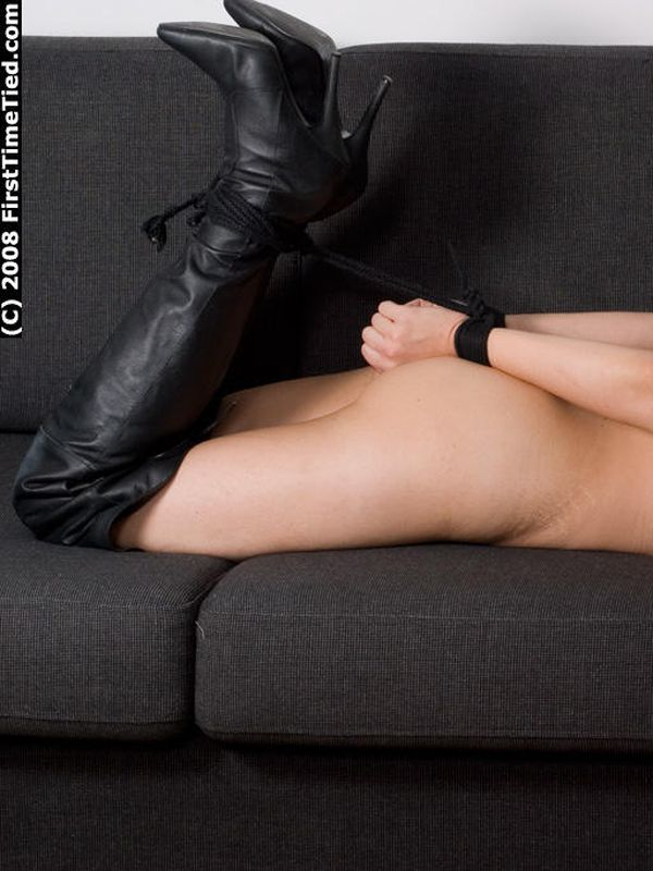 DONNA HOGTIED NAKED AND TAPEGAGGED IN LEATHER BOOTS