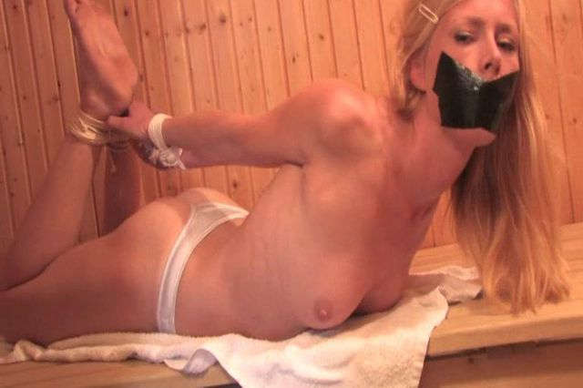 PAULA TIED UP TOPLESS AND TAPEGAGGED IN THE SAUNA