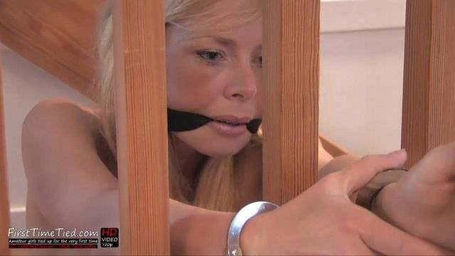 PAULA HANDCUFFED AND CLEAVE GAGGED IN THE STAIRS
