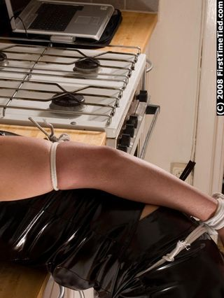 DONNA TIED UP TOPLESS IN LATEX DRESS AND DROOLING