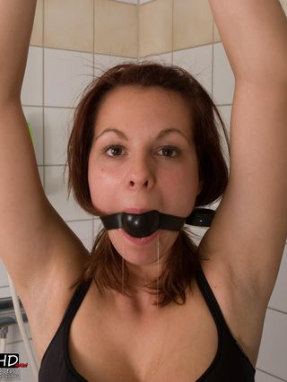 Tindra handcuffed and ballgagged in the shower - 3