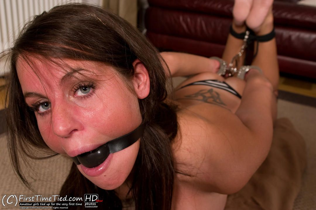 Elin handcuffed, ballgagged and hogtied topless in the livingroom - 3