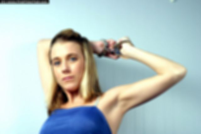 EMMA HANDCUFFED AND CLEAVEGAGGED IN BLUE DRESS