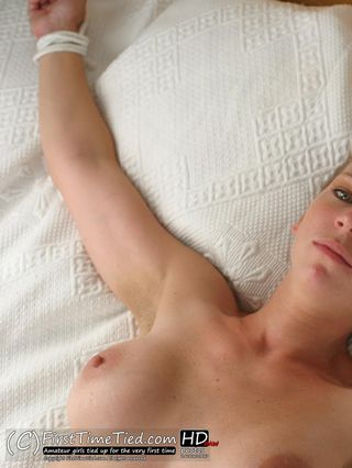 Freja tied up naked in bed spread eagle style - 1