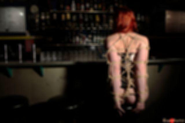 A sensual red head drooling at the bar