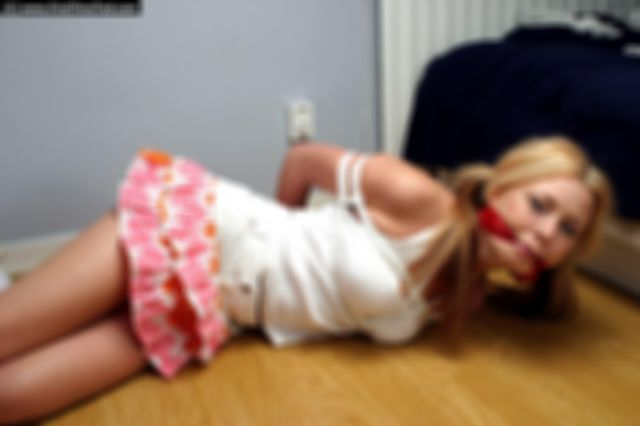 PAULA THE SCHOOLGIRL TIED UP AND CLEAVEGAGGED ON THE FLOOR