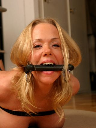 Anna hogtied topless and bit gagged on the floor - 3