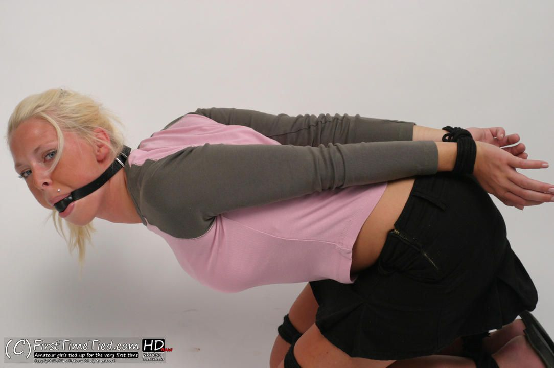 Paula tied up and ballgagged in the studio