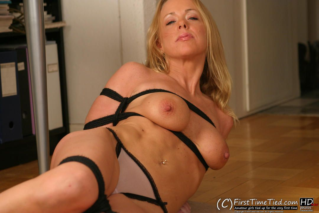 Anna harness tied topless on the floor - 1