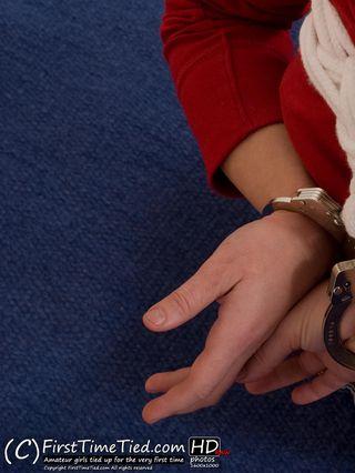 Katarina harness handcuffed on the floor - 1