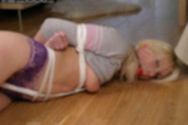VERONIKA TIGHTLY HOGTIED AND BALLGAGGED ON THE FLOOR